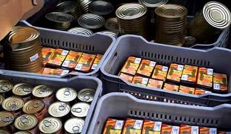 Distribución de alimentos en os barrios santiagueros.