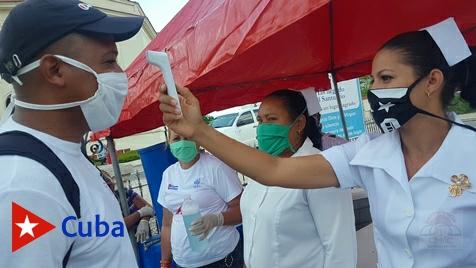 Día de la Patrona de Cuba, despertó diferentes el poblado de El Cobre, con todas las restricciones sanitarias. Texto y foto: Santiago Romero Chang